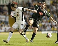 Photo: Aidan Ellis.<br /> Leeds United v Plymouth Argyle. Coca Cola Championship. 07/04/2007.<br /> Leeds Jonathon Douglas (L) and Plymouth's David Norris