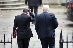© Licensed to London News Pictures. 10/10/2017. Foreign Secretary Boris Johnson (R) and Trade Secretary Liam Fox talk together as they leave Number 10 Downing Street and head to the Foreign Office after attending the weekly cabinet meeting. London, UK. Photo credit: Peter Macdiarmid/LNP