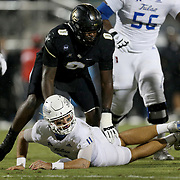 FL - OCTOBER 03:  Zach Smith #11 of the Tulsa Golden Hurricane looks at a fumble recovery as Kenny Turnier #0 of the Central Florida Knights stands over him at Bright House Networks Stadium on October 3, 2020 in Orlando, Florida. (Photo by Alex Menendez/Getty Images) *** Local Caption *** Zach Smith; Kenny Turnier