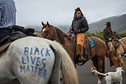 Brianna Noble with her horse, Dapper Dan prepares to lead the ride at a Black Lives Matter horse ride through the Marin Headlands. Photographed on 7/26/20.