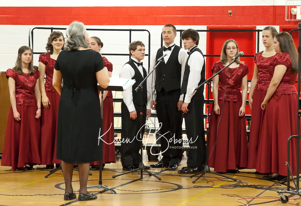 Music Teacher Debbie Gibson leads the LHS concert choir during the Spring Concert held Tuesday evening at the Laconia High School gymnasium.  (Karen Bobotas/for the Laconia Daily Sun)