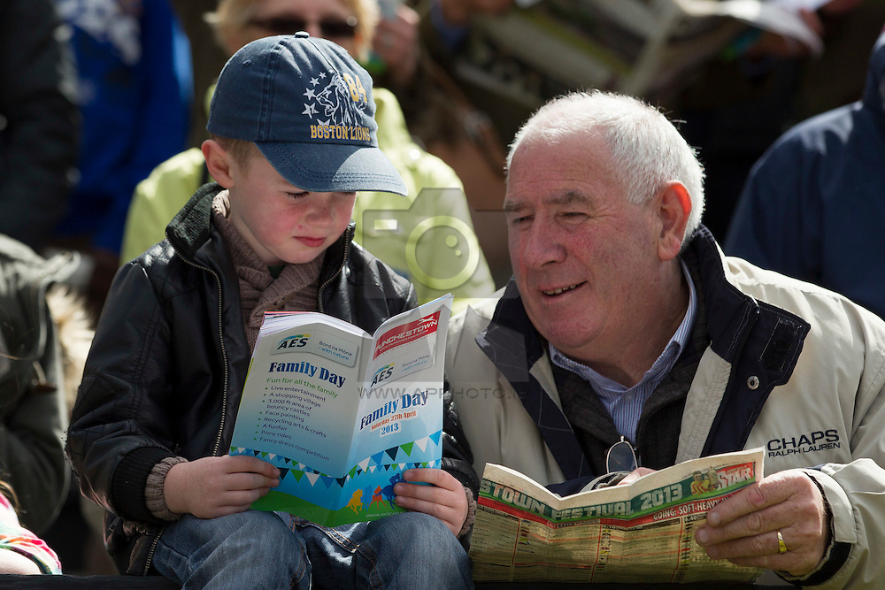 Repro Free: Brandon Teeling 4 from Kill Co Kildare gives grandad Joe Delahunt a few tips at the AES Bord na Mona Family Day at Punchestown Racing Festival on Saturday, 27th April 2013. Picture Andres Poveda .Further information on AES Waste Management and the AES Bord na Mona Family Day at Punchestown is available on ttp://www.aesirl.ie/ and http:/www.punchestown.com.