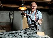 Hans Rhyner in der schieferwerkstatt in elm mit schiefer vom landesplattenberg am 12. juli 2012<br />photo siggi bucher