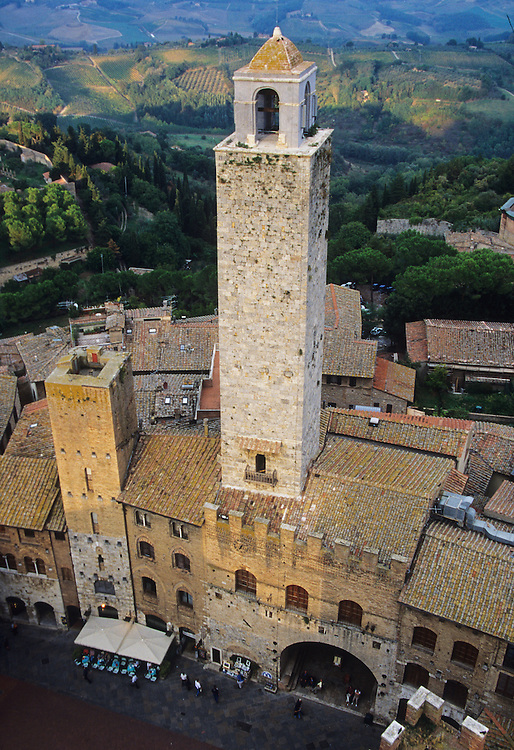 Europe, Italy, Tuscany, San Gimignano, tower (13th century) and plaza, viewed from the top of another medieval tower