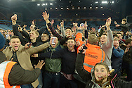 Aston Villa fans celebrate on the pitch after the final whistle as stewards try to hold them back. The FA cup, 6th round match, Aston Villa v West Bromwich Albion at Villa Park in Birmingham, Midlands on Saturday 7th March 2015<br /> pic by John Patrick Fletcher, Andrew Orchard sports photography.