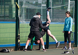 © Licensed to London News Pictures. 28/03/2020. London, UK. Members of the public exercising closely with a personal trainer at Paddington Recreation Ground in London, during a lockdown over the spread of COVID-19. Prime Minister Boris Johnson has announced that people should only leave their homes for essential work, groceries, medical necessity and exercise. Photo credit: Ben Cawthra/LNP