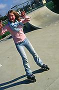 AF5CP0 Children playing at a skate park