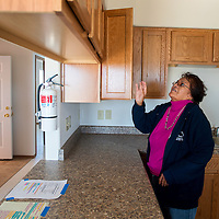 101513       Brian Leddy<br /> Martha Morgan inspects the kitchen of a newly remodeled home in Crownpoint. Morgan is a homeowner in the Navajo Housing Authority subdivision that was recently remodeled.