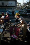 A man and his motorcycle, in Bangkok, Thailand. PHOTO TIAGO MIRANDA