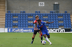 Kwame Poku of Colchester United runs past Conor McAleny of Oldham Athletic with the ball - Mandatory by-line: Arron Gent/JMP - 03/10/2020 - FOOTBALL - JobServe Community Stadium - Colchester, England - Colchester United v Oldham Athletic - Sky Bet League Two