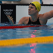 Emily Seebohm, Australia, reacts after breaking the Olympic record in the Women's 100m backstroke heats during the swimming heats at the Aquatic Centre at Olympic Park, Stratford during the London 2012 Olympic games. London, UK. 29th July 2012. Photo Tim Clayton