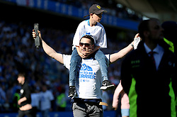 Huddersfield Town fans invade the pitch at the end of the match