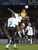 Photo. Glyn Thomas.<br /> Fulham v Blackburn. FA Barclaycard Premiership. <br /> Loftus Road, Luton. 12/04/2004.<br /> Fulham's Luis Boa Morte (second from L) fights an aerial battle for possession with Lucas Neill.