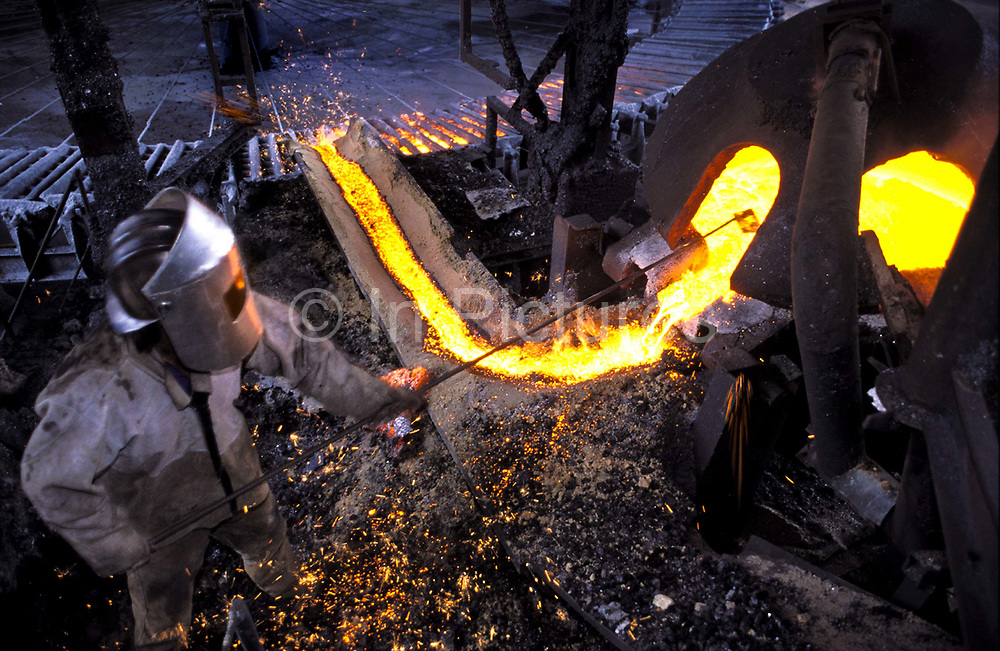 Worker making Pig Iron at a plant in Divinopolis, Minas Gerais, Brazil