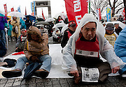 Union activists at a rally organized by Doro Chiba labour union to protest the outsourcing of what they consider essential safety and repair work and fight against rationalization of JR (Japan Railways) business. They also protested for the reinstatement of 1,047 national railway workers who lost their jobs in 1987. Shibuya, Tokyo, Japan Saturday, February 13th 2010