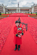 A bagpipe tribute plaed by Chelsea Pensioner Michael Shanahan - 5000 Poppies, startes as a tribute by Lynn Berry and Margaret Knight to their fathers who fought in WW2 and, with the help of creative Director Phillip Johnson, became a project where over 50000 contributors submitted more than a quarter of a million hand knitted poppies.