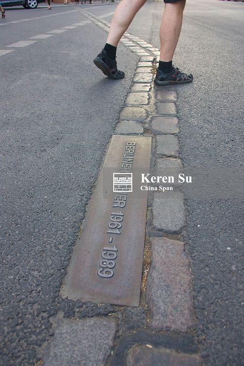 Line where the old Berlin Wall sat with writing on the ground, Berlin, Germany