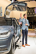 """New York, NY, USA-23 March 2016. Lincoln showed its Navigator concept car, with fold-out steps and motorized lift doors. For scale, the man beside it is 6'4"""" (193cm) tall."""