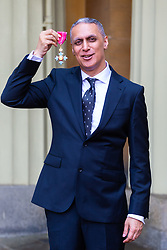 Musician and composer Nitin Sawhney proudly displays his OBE for services to music at an investiture ceremony conducted by Prince William, Duke of Cambridge at Buckingham Palace. London, May 09 2019.