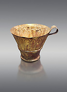 Mycenaean gold cup with arches decoration, Grave V, Grave Circle A Mycenae, Greece. National Archaeological Museum of Athens. Grey Background<br /> <br /> <br /> An elegant precious gold cup hammered from thick gold to created a simple elegant design. This Mycenaean gold cup demonstrates how advance Mycenaean metalworking was in the 16th century BC. The value of the cup would have been extermely high so must have graced the table of a Mycenaean noble perhaps even a v king. .<br /> <br /> If you prefer to buy from our ALAMY PHOTO LIBRARY  Collection visit : https://www.alamy.com/portfolio/paul-williams-funkystock/mycenaean-art-artefacts.html . Type -   Athens    - into the LOWER SEARCH WITHIN GALLERY box. Refine search by adding background colour, place, museum etc<br /> <br /> Visit our MYCENAEN ART PHOTO COLLECTIONS for more photos to download  as wall art prints https://funkystock.photoshelter.com/gallery-collection/Pictures-Images-of-Ancient-Mycenaean-Art-Artefacts-Archaeology-Sites/C0000xRC5WLQcbhQ