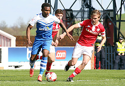 Peterborough United's Kgosi Ntlhe is watched by Barnsley's Luke Berry - Photo mandatory by-line: Joe Dent/JMP - Mobile: 07966 386802 - 18/04/2015 - SPORT - Football - Barnsley - Oakwell - Barnsley v Peterborough United - Sky Bet League One