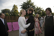 Tilda Swinton and Stefano Pilati, The Summer Party sponsored by Yves St. Laurent. Serpentine Gallery. 11 July 2006. . ONE TIME USE ONLY - DO NOT ARCHIVE  © Copyright Photograph by Dafydd Jones 66 Stockwell Park Rd. London SW9 0DA Tel 020 7733 0108 www.dafjones.com