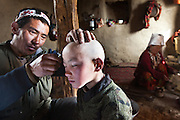 Khairuddin's father hopes that shaving his son's head?and putting the hair in a ?clean place,? such as a frozen river?will cure the boy's persistent headaches. Although the Kyrgyz are Sunni Muslims, their rituals also reflect other ancient traditions. They believe that evil spirits cause many medical problems...The Kyrgyz settlement of Tchelab, near Chaqmaqtin lake, Haji Bootoo Boi's camp...Trekking through the high altitude plateau of the Little Pamir mountains, where the Afghan Kyrgyz community live all year, on the borders of China, Tajikistan and Pakistan.