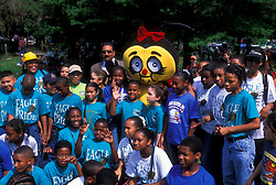 Stock photo of a group of students posing with a bee mascot at the International Festival in downtown Houston Texas