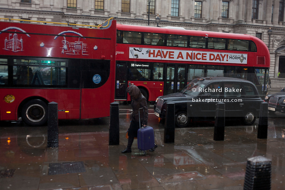 'Have a Nice Day' banner on a central London bus during a morning shower in Whitehall, central London.