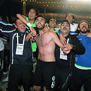 Konyaspor's players Yusuf KURTULUS (R), Ufukhan BAYRAKTAR (C), celebrates victory during their Turkish soccer Play Off final match Altayspor between Konyaspor at Ataturk Olympic Stadium in Istanbul Turkey on Sunday, 23 May 2010. Photo by TURKPIX