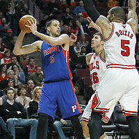 30 March 2012: Chicago Bulls shooting guard Kyle Korver (26) and Chicago Bulls power forward Carlos Boozer (5) defend on Detroit Pistons small forward Austin Daye (5) during the Chicago Bulls 83-71 victory over the Detroit Pistons at the United Center, Chicago, Illinois, USA. NOTE TO USER: User expressly acknowledges and agrees that, by downloading and or using this photograph, User is consenting to the terms and conditions of the Getty Images License Agreement. Mandatory Credit: 2012 NBAE (Photo by Chris Elise/NBAE via Getty Images)