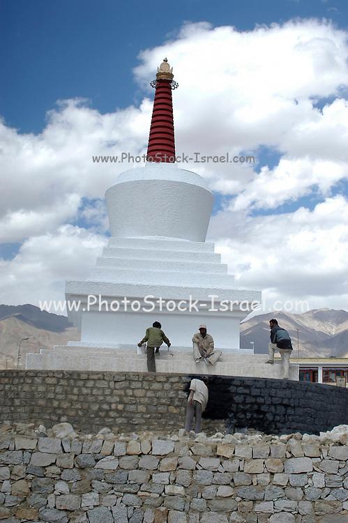 India, Ladakh region state of Jammu and Kashmir, exterior of the leh Monastery whitewashing the exterior of the Leh Monastery