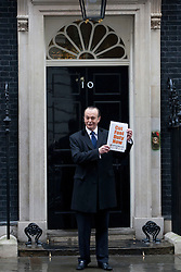 © licensed to London News Pictures. London, UK 07/03/2012. Quentin Willson posing outside 10 Downing Street, before handing in FairFuel's report about high fuel prices in the UK. Photo credit: Tolga Akmen/LNP