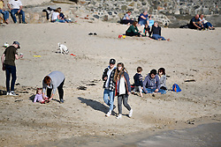 © Licensed to London News Pictures. 22/03/2020. St. Ives, UK. On the beach in St Ives. Business in the holiday town of St Ives has shut its doors to visitors in response to the Corona Virus pandemic. Photo credit: MARK HEMSWORTH/LNP