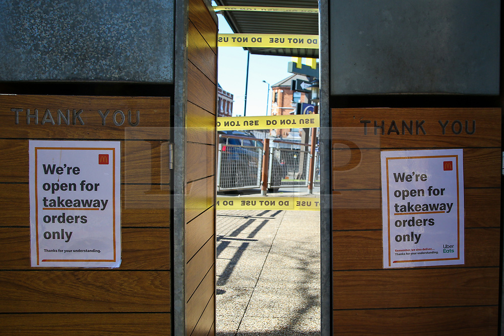 © Licensed to London News Pictures. 23/03/2020. London, UK. A 'We're open for takeaway orders only' sign outside <br /> McDonald's in Haringey north London, with seating area sealed off. McDonald's restaurants across the UK are to close from 7pm tonight as the spread of the coronavirus continues in the country. Photo credit: Dinendra Haria/LNP