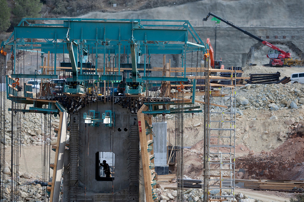 A worker is seen at the construction site for bridge number 8, along the route of the high-speed railway between Tel Aviv and Jerusalem, on november 1, 2011. The new railway, set to be completed in 2017, will span about 55 kilometers and include a series of bridges and tunnels. It will connect Israel's capital to the Greater Tel Aviv Metropolitan Area by means of a high-speed rail link, reducing the travel time between the two cities to approximately half an hour.