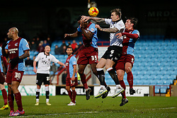 Aden Flint of Bristol City is challenged by Isaiah Osbourne and Niall Canavan of Scunthorpe United - Photo mandatory by-line: Rogan Thomson/JMP - 07966 386802 - 17/01/2015 - SPORT - FOOTBALL - Scunthorpe, England - Glanford Park - Scunthorpe United v Bristol City - Sky Bet League 1.