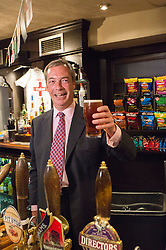 (c) Licensed to London News Pictures. 23/05/2014 Essex, UK. After a successful day at the local elections, UKIP leader Nigel Farage visits some key places in Essex. He stopped to meet local UKIP councillors at the Hoy and Helmet PH in South Benfleet where he pulled the obligatory pint of beer for the press. Photo credit Simon Ford/LNP
