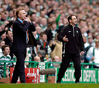 Photo. Jed Wee, Digitalsport<br /> Glasgow Celtic v Glasgow Rangers, Scottish FA Cup, Celtic Park, Glasgow. 07/03/2004.<br /> Rangers manager Alex McLeish (L) and Celtic counterpart Martin O'Neill get animated in urging their team on.