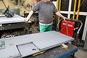 A prisoner at Coldingley makes prison doors in the steel workshop.<br /> HMP Coldingley, Surrey was built in 1969 and is a Category C training prison. Coldingley is focused on the resettlement of prisoners and all prisoners must work a full working week within the prison. Its capacity is 390 prisoners.