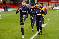 Wimbledon forward Tommy Wood (22) warming up  during the The FA Cup 3rd round match between Fleetwood Town and AFC Wimbledon at the Highbury Stadium, Fleetwood, England on 5 January 2019.