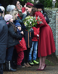 The Duchess of Cambridge children outside the church as she arrives to attend the Christmas Day morning church service at St Mary Magdalene Church in Sandringham, Norfolk.