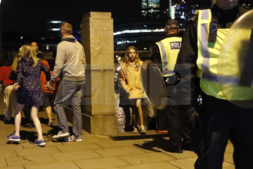© Licensed to London News Pictures. 03/06/2017. London, UK. People are being evacuated after reports of a terrorist incident involving a vehicle and pedestrians in London Bridge.  Reports are saying a white transit van may have deliberately run down people crossing the bridge. Photo credit: Tolga Akmen/LNP