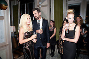 DONATELLA VERSACE; RUPERT EVERETT; JANUARY JONES, Donatella Versace celebrates the launch of the CSM 20:20 Fund, at the Connaught Hotel, Mayfair, London, 11th November, 2010. -DO NOT ARCHIVE-© Copyright Photograph by Dafydd Jones. 248 Clapham Rd. London SW9 0PZ. Tel 0207 820 0771. www.dafjones.com.