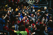 Brokers working at the London International Financial Futures Exchange (LIFFE) on the trading floor in the 90s. Otherwise known as the Pit where Derivatives, Options, Futures and their contracts are exchanged in a frenzy of arm and hand expressions which communicate prices and quantities. The LIFFE exchange was synonymous with Thatcherite capitalist money-making ethos in the City of London of the 80s and early 90s before the takeover by Euronext in January 2002. It is currently known as Euronext.liffe. Euronext subsequently merged with New York Stock Exchange in April 2007.