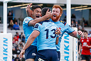 Izaia Perese of the Waratahs celebrates with teammates after scoring during the Round 3 Trans-Tasman Super Rugby match between the NSW Waratahs and the Canterbury Crusaders at WIN Stadium in Wollongong, Saturday, May 29, 2021. (AAP Image/David Neilson) NO ARCHIVING, EDITORIAL USE ONLY