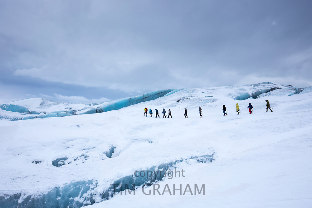 Tourists on glacier hike on Svinafellsjokull glacier, an outlet glacier of Vatnajokull, South Iceland