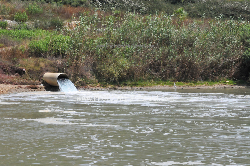 Surface runoff flows into Hadera river, Israel. Runoff water usually contains dirt and pollution carried with it