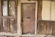 Old door to a tudor building near Hever, England, United Kingdom.