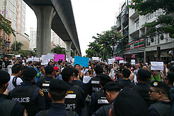 © Licensed to London News Pictures. 24/05/2014. Anti-Coup protestors hold up banners showing their displeasure  towards the Military Junta while facing off with riot police following a Anti-Coup protest in Bangkok Thailand. The Royal Thai army announced a Military coup and have imposed a 10pm curfew.  Photo credit : Asanka Brendon Ratnayake/LNP